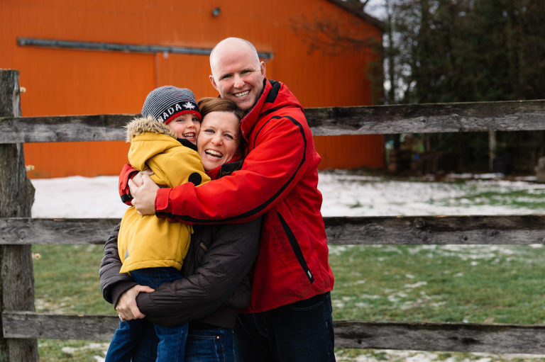 Family of three portrait in the snow