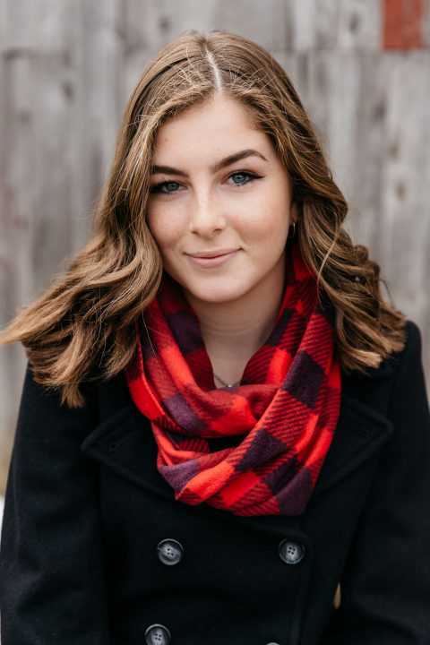 Young woman in a buffalo plaid scarf