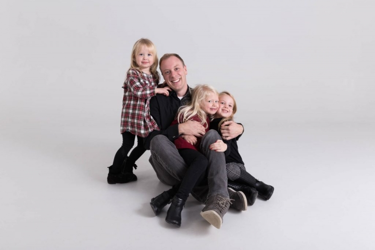 Dad and his daughters, Christmas portrait in studio