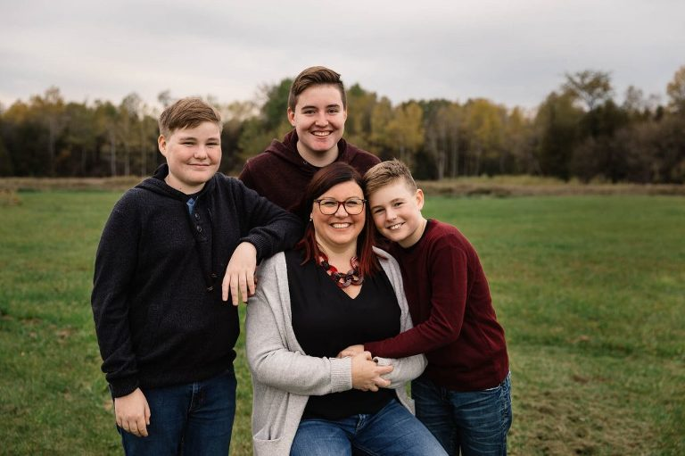 Emotive family portrait of mom and her three boys