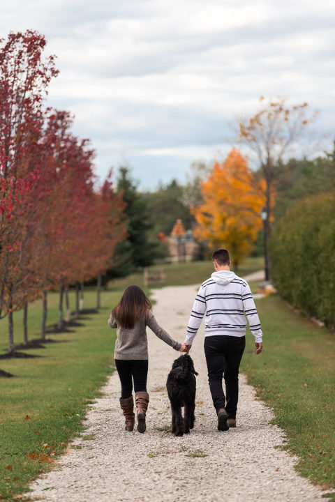 Young couple holding hands walking in the fall