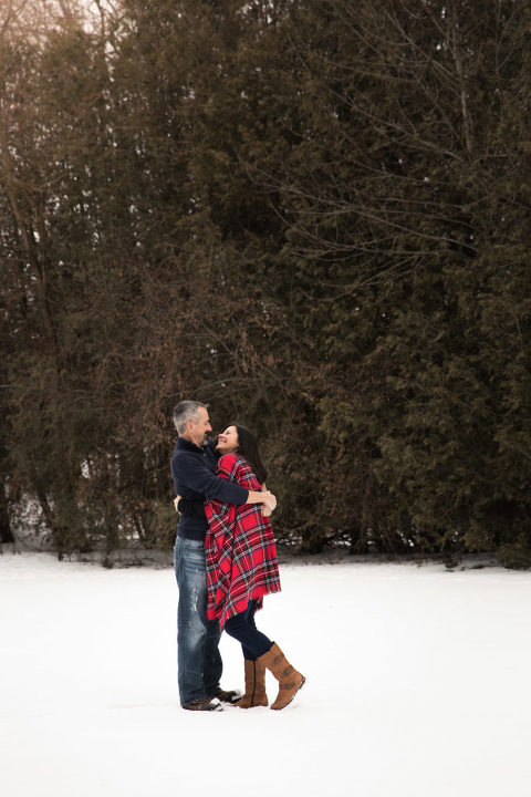 Winter portrait session couple in embrace in the snow
