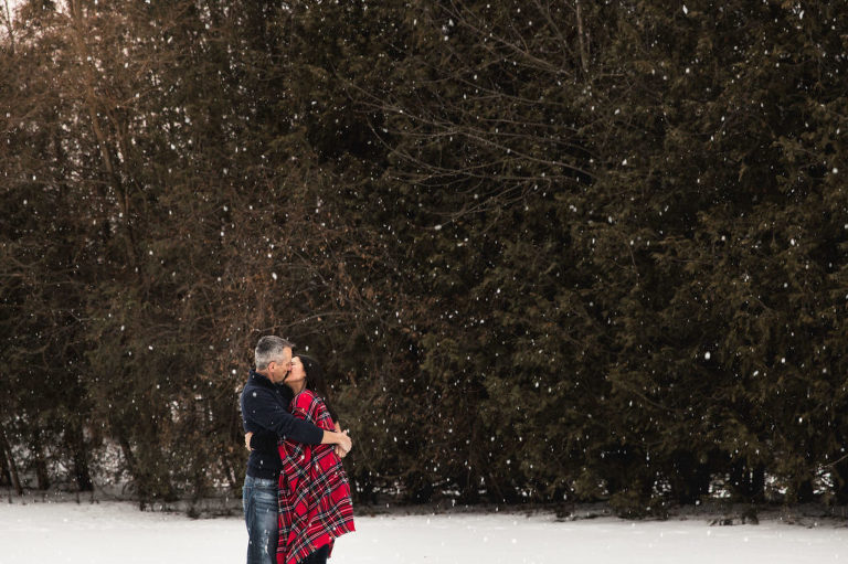 Romantic couple kissing in the snow
