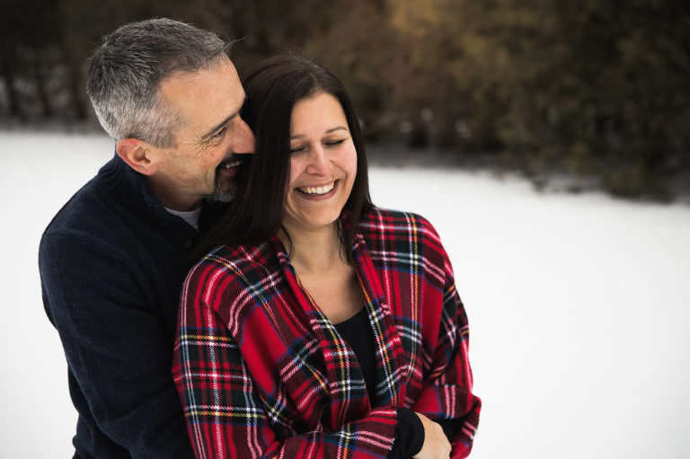 Winter engagement session woman laughing